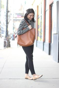 Oversized black and white striped turtleneck with distressed denim and Madewell monogram tote