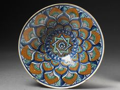 Peacock Plate      Place of origin:      Faenza, Italy (probably, made)     Date:      ca. 1480-1490 (made)     Artist/Maker:      Unknown (production)     Materials and Techniques:      Tin-glazed earthenware. painted     Credit Line:      Bequeathed by George Salting     Museum number:      C.2069-1910