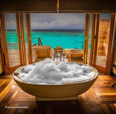The magical bathtub in a sunset ocean suite. Photo by @mohamedalshehhi. #Maldives #island #vacation #honeymoon