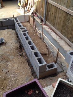 Missed a couple of steps. First two courses of brick laid. Had to do an extra pour on the upper level so it was a) flat and b) at the right height. Back Garden Design, Garden Design Plans, Modern Garden Design, Small Courtyard Gardens, Front Gardens, Small Backyard Landscaping, Backyard Patio, Landscaping Ideas, Cinder Block Garden