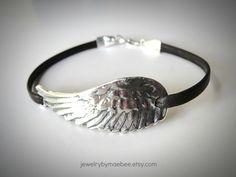 now on leather...sterling silver bird wing bracelet from JewelryByMaeBee on #Etsy. #sfetsy www.jewelrybymaebee.etsy.com