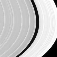 The Cassini Division is a 4,800 km (3,000 mi) wide region between the A Ring and B Ring. It was discovered in 1675 by Giovanni Cassini at the Paris Observatory using a refracting telescope that had a 2.5 inch objective lens with a 20 foot long focal length and a 90x magnification.[55][56] From Earth it appears as a thin black gap in the rings. However, Voyager discovered that the gap is itself populated by ring material bearing much similarity to the C Ring.