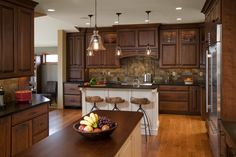 ROB - this style and color for cabinets and hardware. Love the black countertop.