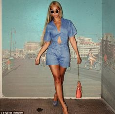 Sasha Fierce: Beyonce, who also wore wayfarers and pink lipstick, pulled poses in front of a beach scene backdrop