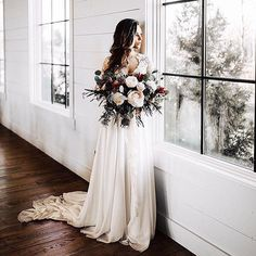 3a785651b6d must take photos wedding dress a bride with bouquets near a window peyton  rainey photography. Pure Bridal Boutique · Lillian West 6422