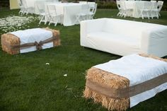 Hay and flower decorations | During dinner, we used couches, haybales and bistro lighting to ...