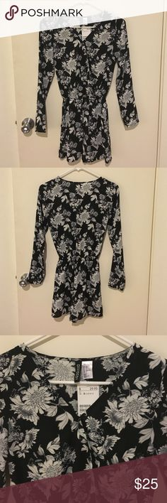 New with tags. H&M black floral sexy romper New with tags! H&M black floral romper. Above pictures show buttoned and unbuttoned options. Also has pockets! H&M Other