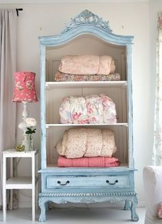 take the front off an old cabinet to store and display pretty bedding