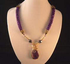 Purple Viking Knit Dragon Veins Necklace & Earrings. $88.00, via Etsy.