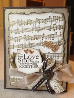 "Stamp Sets: One in a Million, Music Notes Stampin' Around Wheel. Ink: VersaMark, Crumb Cake, Early Espresso. Paper: Very Vanilla, Early Espresso, Brushed Gold Cardstock, Champagne Glimmer Paper. Other: Apothecary Accents Framelits, Stampin' Around Handle, Gold EP, Heat Tool, Early Espresso EP, 1/2"" Crumb Cake Seam Binding Ribbon, 1/4"" Early Espresso Stitched Grosgrain Ribbon, Victoria Crochet Trim, Antique Brads, Small Heart Punch, Owl Punch, Basic Pearls, Sponges."