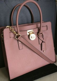 Michael Kors Leather Dusty Rose Tote Bag. Get one of the hottest styles of the season! The Michael Kors Leather Dusty Rose Tote Bag is a top 10 member favorite on Tradesy. Save on yours before they're sold out!