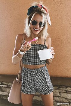 A pair of woven shorts featuring an allover gingham plaid print, a ruffle trim, concealed side seam zipper, and form-fitting silhouette.