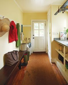 A large mudroom with a bluestone countertop from a local quarry puts outdoor…