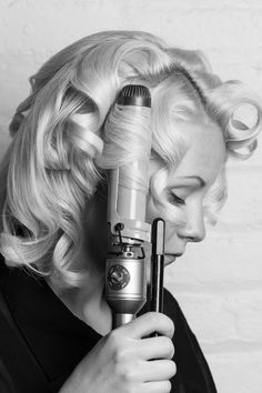 """VINTAGE WAVES Start with straight or freshly blown-out hair. Make a side part and begin curling sections of hair inward with a 3.5-inch barrel curling iron. """"It's important to curl hair toward your face for the 'lift' off of the scalp that creates a vintage feeling,"""" says Gregory Patterson, lead stylist for blow. """"It also forces the S-shape of the curls to bend into the face after brushing them out."""""""