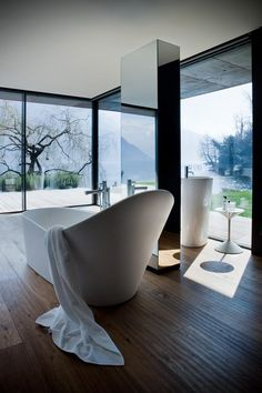 Bathroom with a view... looks like Lac Leman at Montreux.