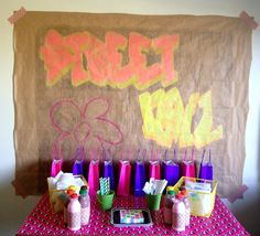Graffiti backdrop with a paper roll and neon crayons | Being Spiffy