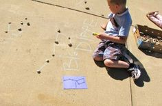 Learning about the night sky: Constellation art with rocks and chalk.