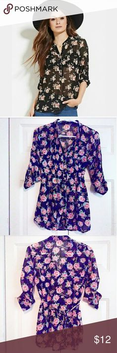 F21 floral pleated tie waist sheet blouse  Listing  ✳Sheet blouse  ✳Red floral design against a black backdrop, ✳Pleated center ✳6 button closure ✳Buttoned sleeves that can be adjusted to wear long sleeve or short ✳Tie waist for a fitted appearance.  ✳A mandarin type collar at neck. ✳Size Small ✳100% Polyester ✳Gently worn a few times. In great condition! ✳1st photo is similar but not exact blouse being sold.  Perfect with pencil skirts and heels for a date night or out on the town! Such a…