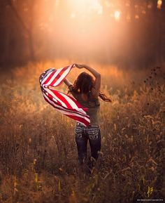Born On The 4th by Jake Olson Studios on 500px I chose this photographer for his hometown great American style. He combines, light, oranges, with emphasis on family.