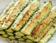 Baked Parmesan Zucchini - Crisp, tender zucchini sticks oven-roasted to perfection. It's healthy, nutritious and completely addictive! Great way for using our garden zucchini! Zucchini Sticks, Zucchini Fries, Zucchini Cookies, Zucchini Bread, Zucchini On The Grill, Healthy Zucchini, Side Dish Recipes, Veggie Recipes, Cooking Recipes