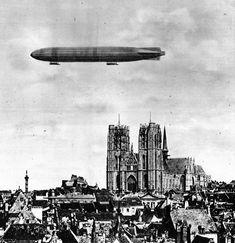1915, a Zeppelin above the Cathédrale Saints-Michel-et-Gudule - Credit: L'Actualité illustrée