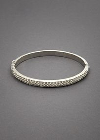 Mayb toe or three stacked???  Sophisticated and graceful this modern interpretation on a classic design is a sparkling and elegant accessory to compliment your look on your wedding day. Each clear pave crystal embellishment catches the light and reflects your style in the loveliest way! Features and Facts:   Dimensions: 2.5 W x 2 H Inner Oval Diameter  Available in either a beautiful gold pl…