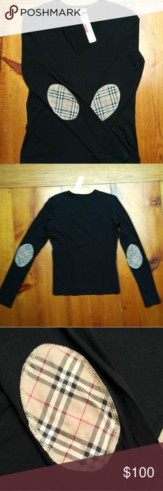 Burberry Long Sleeved T-Shirt Cute Burberry v-neck top with Novacheck patches on the sleeves. Purchased from The Real Real with their tags still on it (not original Burberry tags). Burberry Tops Tees - Long Sleeve