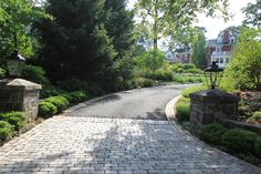 Apron Design NJ, Gutter Design NJ, Cobblestone Apron & Gutters, Drainage Design he boxwoods on the driveway are green gem. The Rhododendron to the left are a mix of Algo and Olga Mezit. The infill of annual color is New Guinea Impatiens as well as shade perennials. Finally behind the large oak is a grove of Cornus Mas.