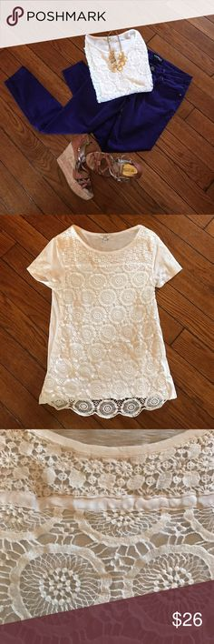 White crochet boho top White crochet boho top.  Beautiful details and trendy for spring and summer.  Crown and Ivy is the in house brand of Belk department stores, popular in the southeast.  This top is high quality and well made. Stretchy, t-shirt material in back and under crochet in front.  Looks a lot like something from Anthropologie or free people.  26 inches long, pit to pit measurement is 15 inches.  Purple skinny jeans available in a separate listing. Crown and Ivy Tops Tees - Short…