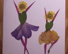 Fait avec des vraies fleurs pressées, pas une impression des danseuses