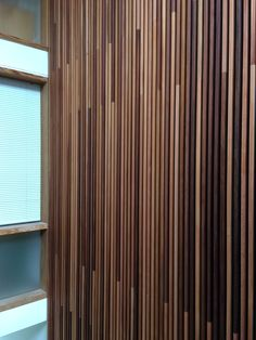 Acoustic wall cladding in solid wood.