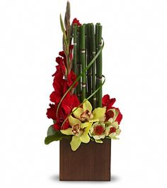 A modern arrangement with Yellow orchids, Red Gladioli delivered with a bamboo-like equisetum. Home Flowers, Flowers For You, Unique Flowers, Exotic Flowers, Purple Flowers, Beautiful Flowers, Send Flowers, House Beautiful, Spring Flowers