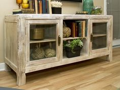 Check out a neutral wood cottage style credenza with glass doors.