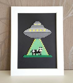 Check out this item in my Etsy shop https://www.etsy.com/listing/538355339/framed-ufo-alien-cow-pixel-art-8-bit