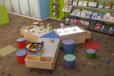 A focal point of the Children's Library. Preschoolers gather and create around Discovery Tables with interchangeable activity tops. (library installation by LFI)