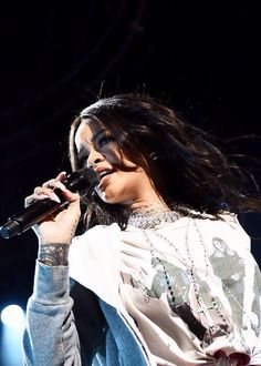 """Rihanna hits the stage to perform her new song """"American Oxygen"""" to a giant crowd on Saturday evening (April 4) in Indianapolis, Ind.  The 27-year-old singer debuted the song for the NCAA's March Madness Music Festival which celebrates the match-up of the Final Four teams."""
