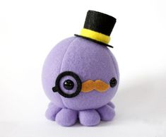 Moustache Octopus Plush w/ Top Hat and Monocle by cheekandstitch i want for em! | Super cute, adorable, tiny plush doll | purple octopus kawaii #kawaii