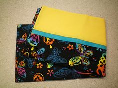 Great gift for all ages - toddler to elderly. Christmas stocking stuffer, birthday, other holiday or just because! Use for travel, summer camp, hunting/fishing camp, travel trailer, watching TV, sleepovers or just for fun! Standard/Queen size pillow case features bright colorful butterflies