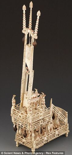 A working model of a guillotine made by a  Napoleonic prisoner, awaiting his death, using scrap animal bone.