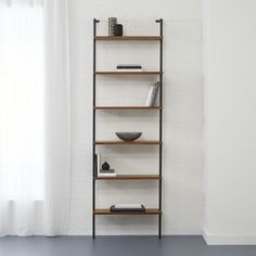 "Shop helix 96"" acacia bookcase.   All the right angles for all the right stuff.  Six fixed acacia veneer shelves stained a warm midtone brown ladder a squared metal tube frame powdercoated carbon."