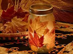 Fall leaves (pressed and dried), mod podge, mason jar