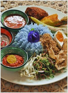 Nasi Kerabu (Kelantan, Malaysia Herb Rice Salad). Nasi kerabu is a Malay rice dish, a type of nasi ulam, in which blue-coloured rice is eaten with dried fish or fried chicken or grilled meat, crackers, pickles and other salads.