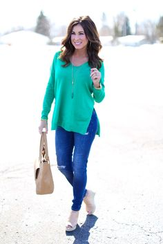 Green Tunic and jeans, neutral shoes, long necklace