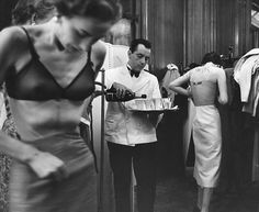 Models backstage at a fashion show in France, 1953. By Kurt Hutton.