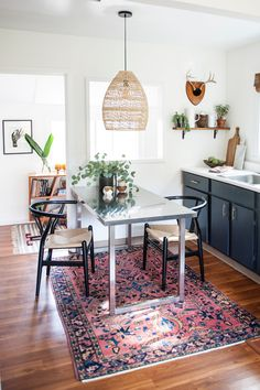 """The light fixture over the table and the vintage Turkish rug were the first two things I bought when I moved in so they definitely guided the design for the entire space in terms of color and the materials that I used,"" says Ashley. ""I love them both!"""