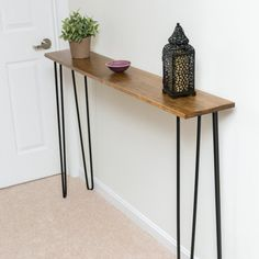 Check out how I made this pretty little console table using a piece of pine that was left over from another project!