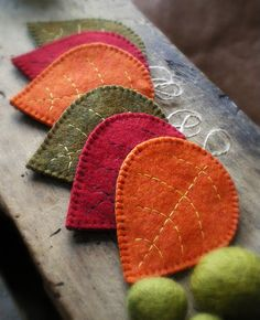 "Little fall leaves sewn from wool or felt. These are actually coasters, but gives me an idea to make them in miniature and turn my tiny kitchen ""Christmas"" tree into a autumn tree with lights and tiny wool leaves for fall. Cute!"