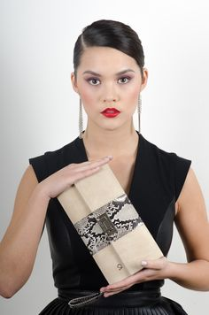 Christopher Augmon (Mary Catherine nude/taupe suede and natural python clutch available currently in stock. $750