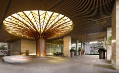 CIMB Investment Bank, Kuala Lumpur, Malaysia. Interior design project by the Steven Leach Group. The Steven Leach Group created a workspace with a strong sense of togetherness for CIMB Investment Bank in Kuala Lumpur, Malaysia. The 'tree of life' sculpture seen at the atrium reflects a strong connection to nature, and a sense of solidity and opulence well suited for a high-end financial firm. For more photos and info about the project and Steven Leach Group follow the link.