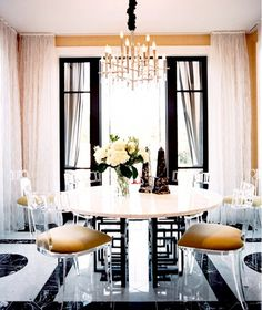 Dining Room With Lucite Chairs and Marble Floor